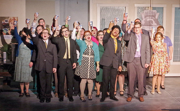 "Mark Maynard | For The Herald Bulletin<br /> In the musical number ""Coffee Break,"" the employees of World Wide Wicket are happy and relieved to finally get their cups of brew in  ""How to Succeed in Business Without Really Trying."""