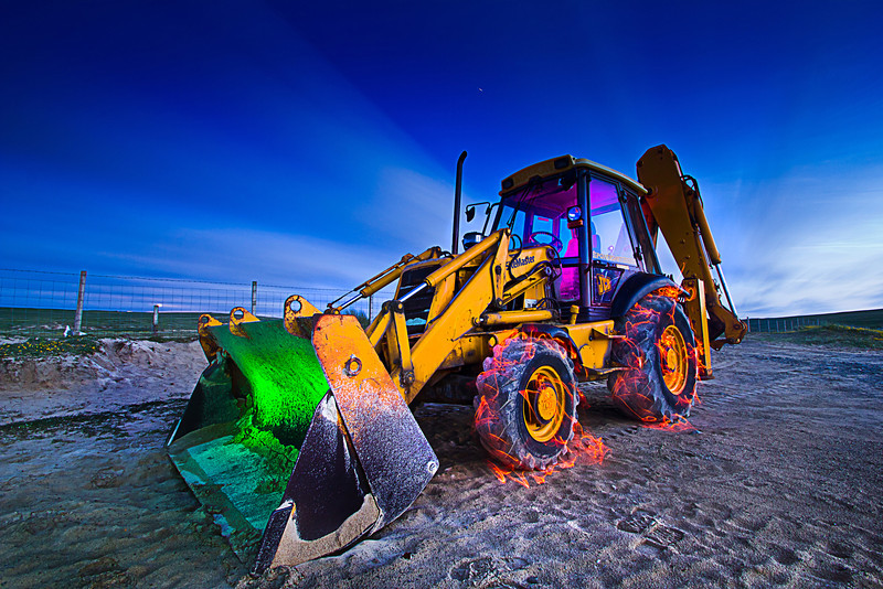Here I walked around the digger lighting various parts with a torch and coloured gels, the 'fire' on the wheels was made with an LED lightstick.<br /> This exposure was about 5 mins long and it was really dark, thats why you don't see me in the frame although I was walking around in it quite alot.