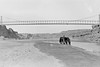 Suspension bridge over the Little Colorado at Cameron, Arizona.<br /> <br /> 3.25x5.5 negatives shot by Howard Clark on the Navajo Reservation near Window Rock, AZ and Fort Defiance, AZ, ca. 1913-35 while he was a Presbyterian minister there. These negatives belong to his daughter, Betty Von Gausig.