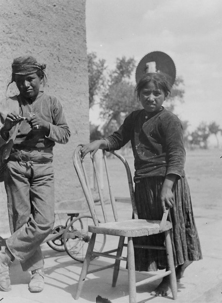 "According to Elizabeth Clark Von Gausg: ""At Fort Defiance trading post. The toy is one assembled by the gardner who like to build things with found scrap parts.""<br /> <br /> 3.25x5.5 negatives shot by Howard Clark on the Navajo Reservation near Window Rock, ca. 1913 while he was a Presbyterian minister there. These negatives belong to his daughter, Betty Von Gausig."