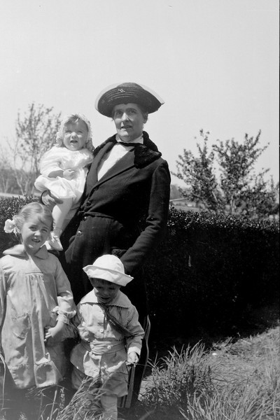 Ethyl Clark (Sawyer) with her three children Elizabeth (Betty Von Gausig), David (in the sailor hat) and Philip.<br /> <br /> 3.25x5.5 negatives shot by Howard Clark on the Navajo Reservation near Window Rock, AZ and Fort Defiance, AZ, ca. 1913-35 while he was a Presbyterian minister there. These negatives belong to his daughter, Betty Von Gausig.