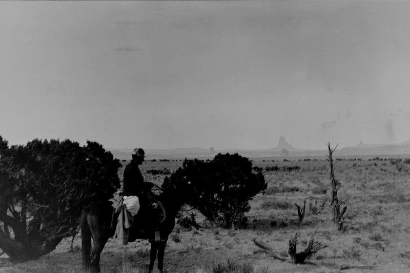 """Near Kayenta, Arizona - note the highest butte called """"El Capitan"""" in English or """"Agathlan"""" in Navajo in the distance.<br /> <br /> 3.25x5.5 negatives shot by Howard Clark on the Navajo Reservation near Window Rock, AZ and Fort Defiance, AZ, ca. 1913-35 while he was a Presbyterian minister there. These negatives belong to his daughter, Betty Von Gausig."""