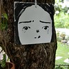A painting of a crying girl on a tree at 10mm cafe in Korat, Thailand in August 2017