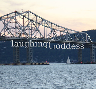Tappan Zee Bridge with sailboats on the water.