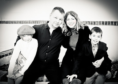 family on brick wall bw-