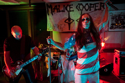 "John Fletcher of Pinckney, aka Ghengis John the Human Firecracker, continues on with his ""Malice Cooper"" band performance after blowing himself up with 6000 firecrackers during a Halloween party at Burroughs Tavern in Brighton, MI on Oct 26, 2012.  At left on guitar is Daniel Feig.  (Mark Bialek / Special to the Det News)"