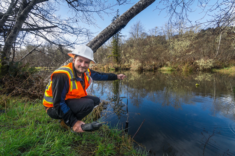 Samuel Price, an environmental biologist, tests the water at Panther Creek, Del Norte County, California, January 2016. [Bald Hills 2016-01 001 Humboldt-CA-USA]