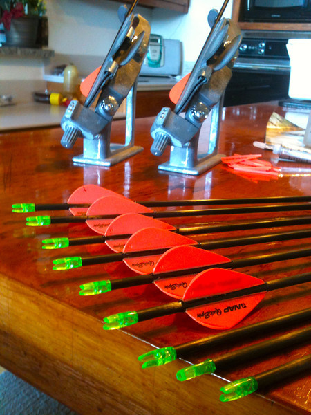 Re-fletching some arrows.