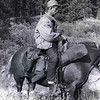 Horseback during hunt in Northern B.C. in 1951. Though I  have traveled many hundreds of miles by horse, I am one of the globe's worst horsemen and it shows in this photo.