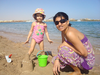 Mommy and Me time.. We loved building sand castles all day..  Just like Olivia and her Mommy. (Book we have to read everyday)