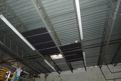 Hurricane Sandy Damage in office and warehouse. Skylights broken in warehouse and edge of roof torn off.