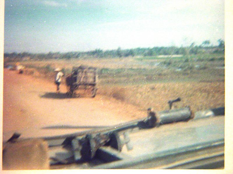 When I first got into VIetnam, I drove a five ton truck, hauling ammo to the troops in the field.  Here I am passing an ox cart on Hwy. #13.
