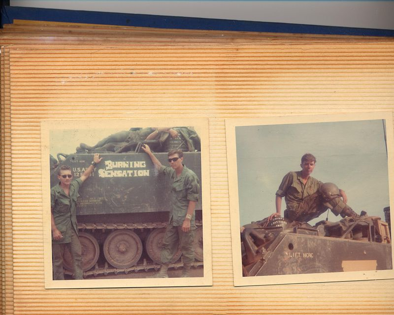 "For about three months I was Track Commander, on what we called a ""Zippo"".  This was an M-113 Armored Personal Carrier, that had a flame thrower mounted on it.  The photo on the right is of me sitting on top of the flame gun, on the flame gun, I had painted, ""Crispy Critters Inc."".  in the lower part of the photo you can see masking tape on the side of the track, we used masking tape as a stencil when we painted the names on the sides of our Tracks.  The photo on the left shows the name we had just painted after cutting it out of the tape, onto the Track, ""Burning Sensation"".  My friend ""Papino"" is standing on the left, I am on the right."