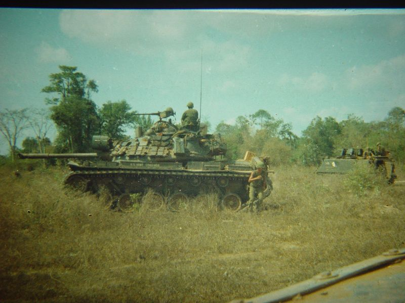 M48A3 and an ACAV pulling security for work being done on a road.