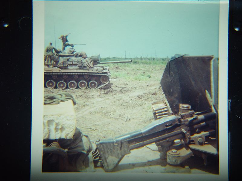 M-60 machine gun mounted on the side of the ACAV, M48A3 in the back ground.