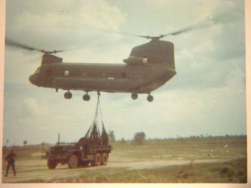 I am getting away from all the dirt and dust being kicked up by the chopper as it lifts this heavy load.