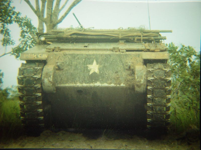 ACAV cresting a rice paddy dike. In this position the guns on the ACAV could not point down enough to fire to the front and prevent being attacked, an RPG could easily take out the track in this type of situation.