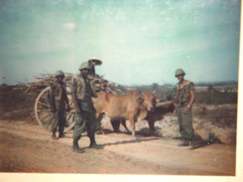 Here Washington, Johnson and myself check an ox cart for contraband.