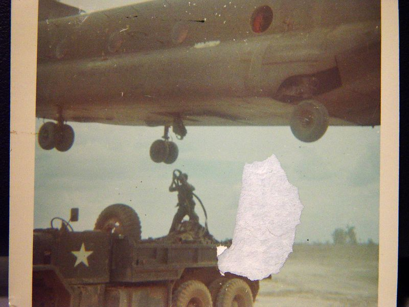 Here I am hooking a load of ammo up to a chopper to be taken to the trrops at a special forces out post just out side of Loc Ninh.