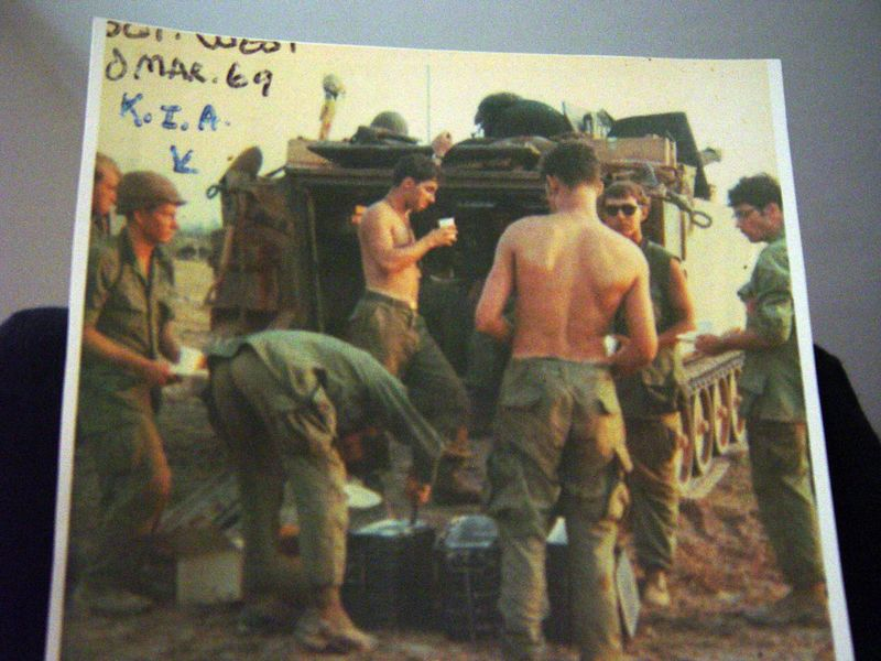 Sgt West was latter killed in action, here we are gathered around the rear of a track getting some hot chow.