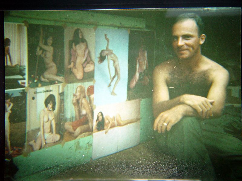 """This is my friend Mike Alongi, displaying the """"wall-paper"""" on the inside of his Track.  Mike was killed during the fight at Fire Base Rita, November 1st. 1968."""