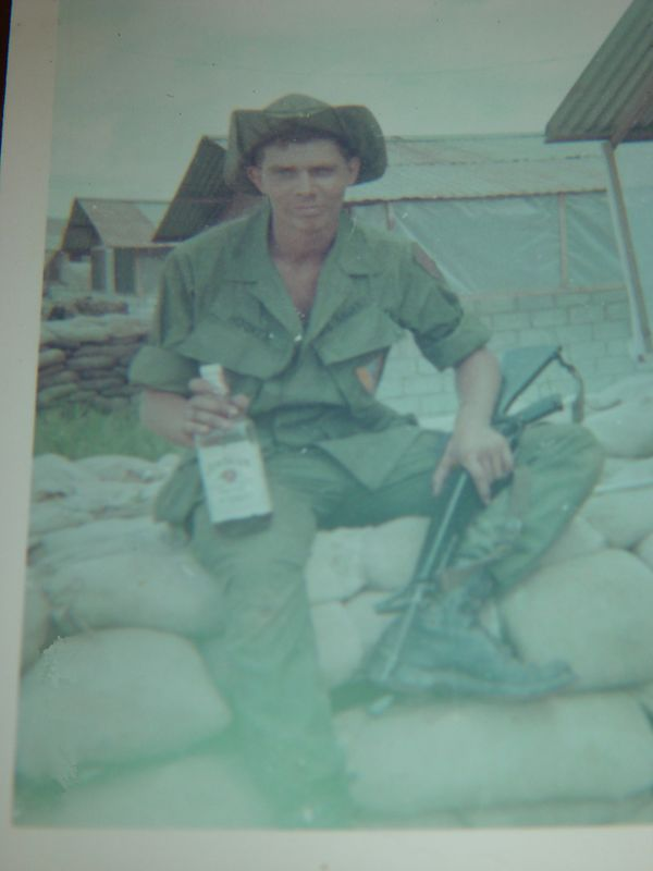 Here I am, just in-country  June 20 something 1967.  Notice the CLEAN new fatigues, shiny new M-16 and half full bottle of Jim Beam.  Yes, when your 19 years old, half drunk and legally in possession of a fully automatic weapon with a license to kill you think your invincible.  It didn't take long to lay those ideas to rest.