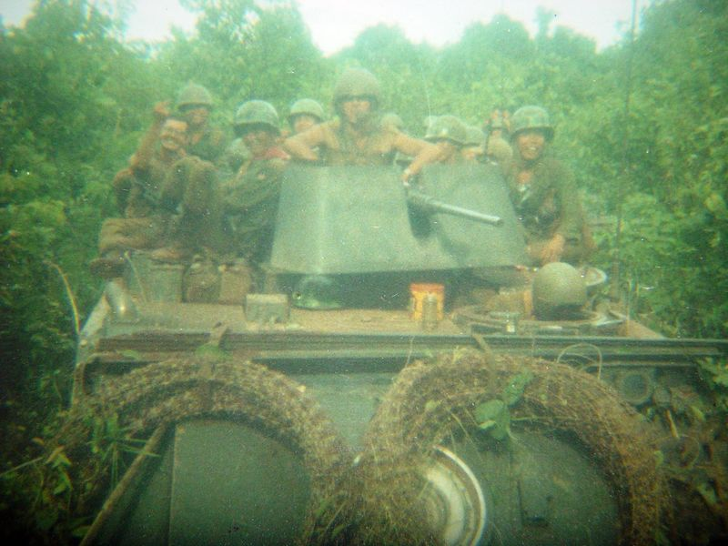 The Infantry riding on top of the ACAV are ARVN's ( Army Republic of Viet Nam ) the barbed wire carried on the front of the track would be placed in front of night defensive positions.