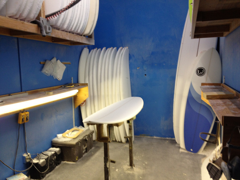 Finished surfboard blank in the shaping room