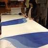 Mariale prepping the board graphic inlays