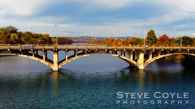 Lady Bird Lake in Austin, looking upstream at the historic Lamar Street Bridge and the fall colors beyond.