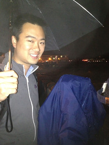 This is Vince a co-worker.  We took turns holding the one umbrella we had so that each of us could take a few shots of the Bay Bridge lights.  Team work FTW.