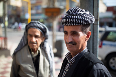 Two Kurdish men wearing the traditional cemedanî head dress in Duhok, Iraqi Kurdistan.