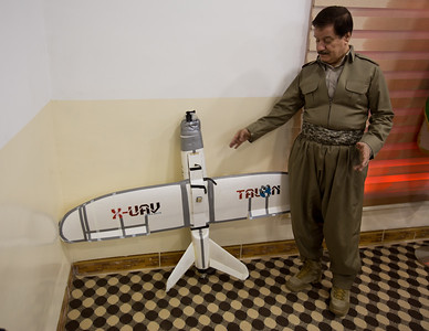 Dr. Kirkuki, former Speaker of the Iraqi Kurdistan Parliament, with an ISIS surveillance drone captured near the city of Kirkuk.