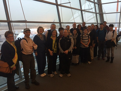 Our group at the airport- our El Al plane behind us, probably as tired as we are!