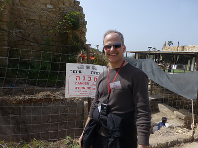 David Smith- Always ready for danger- including the newest archeological discoveries underway behind him