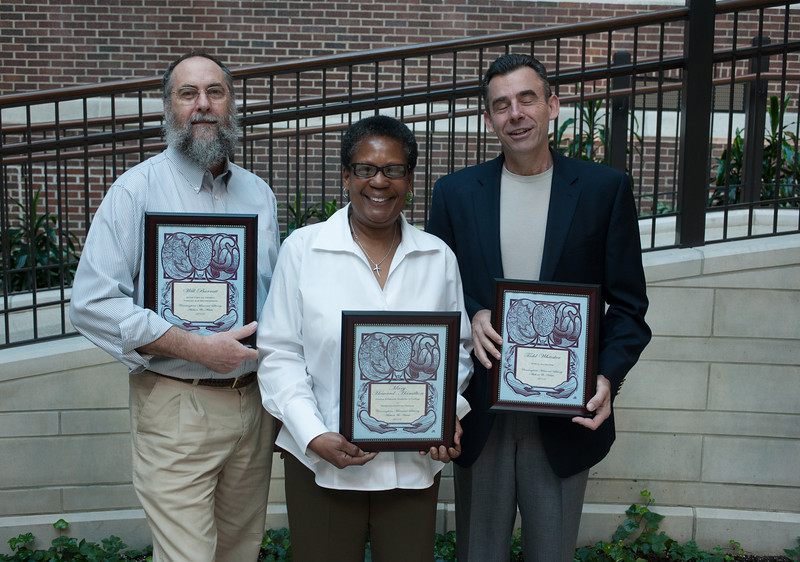 Will Barratt, Mary Howard-Hamilton and Todd Whitaker with plaques commemorating their authorship.