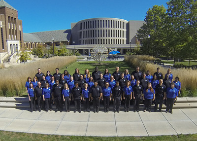 Concert Choir posing in front of the Chorus of Trumpets on Tirey Plaza in 2013