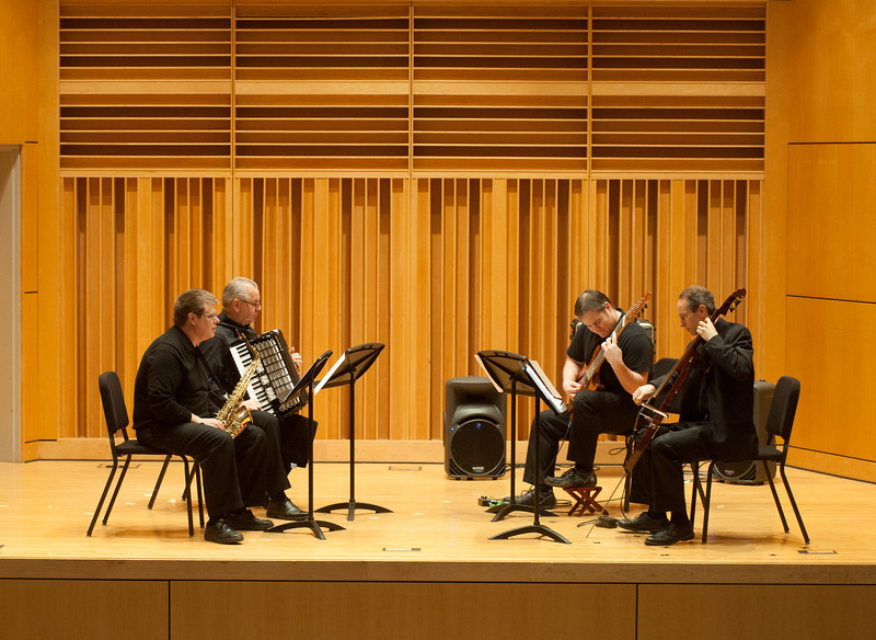 Faculty ensemble performing on stage in recital hall of Center for Performing and Fine Arts