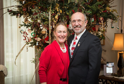 Dan and Cheri Bradley posing in front of holiday docorations in Condit House