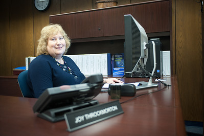Joy Throckmorton poses in her office and the technology building for University Medallion ceremony