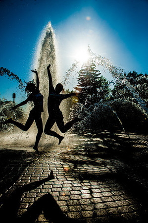 New Student Orientation leaders run through the fountain in Dede Plaza