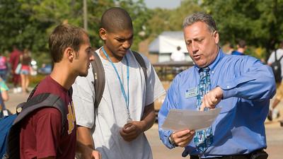 Al Perone asssisting students at Dede Plaza
