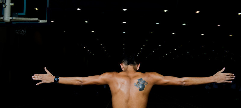 Tattoo of athletics logo on theback of track and field athlete