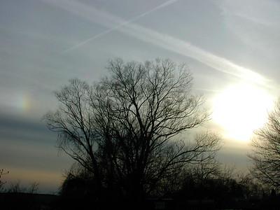 March 6, 2007. On my way home I spied a pair of sun dogs sometimes after 5:00 pm. This eastern dog was the brightest. Later upon examining this image I can see that it was more of an arc the I first suspected. (Click on image to enlarge.)