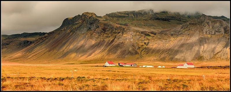 Farm below a caldera,  Snaefellsas peninsula