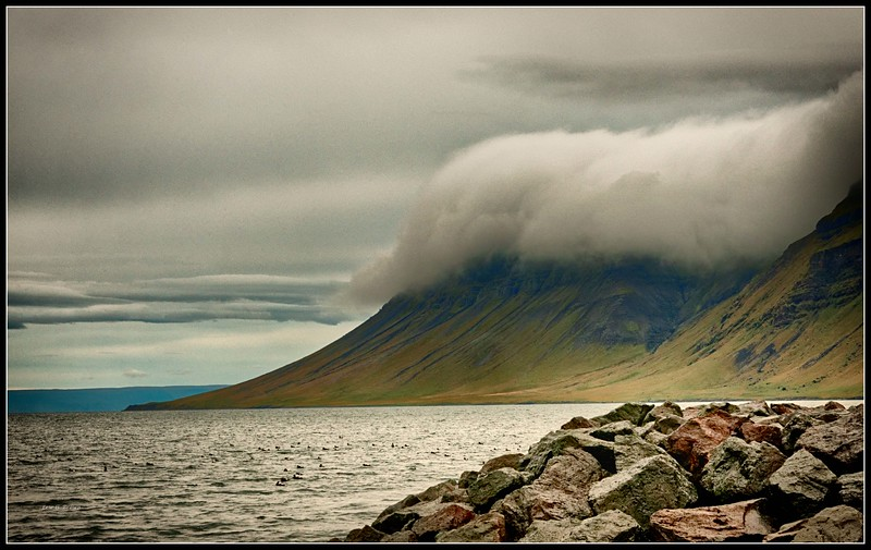 Clouds descending mountain near Grundarfjörður