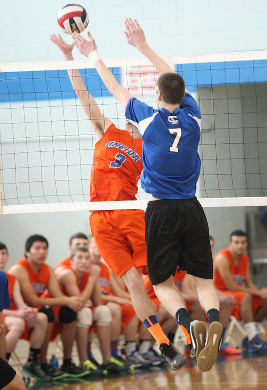. Oneida\'s Andrew Sreca  (3) puts the ball over the net as Ichabod Crane\'s Shane Wenz (7) defends in the NYSPHSAA Class B Regionals in Oneida on Saturday, March 8, 2014. JOHN HAEGER-ONEIDA DAILY DISPATCH @ONEIDAPHOTO ON TWITTER