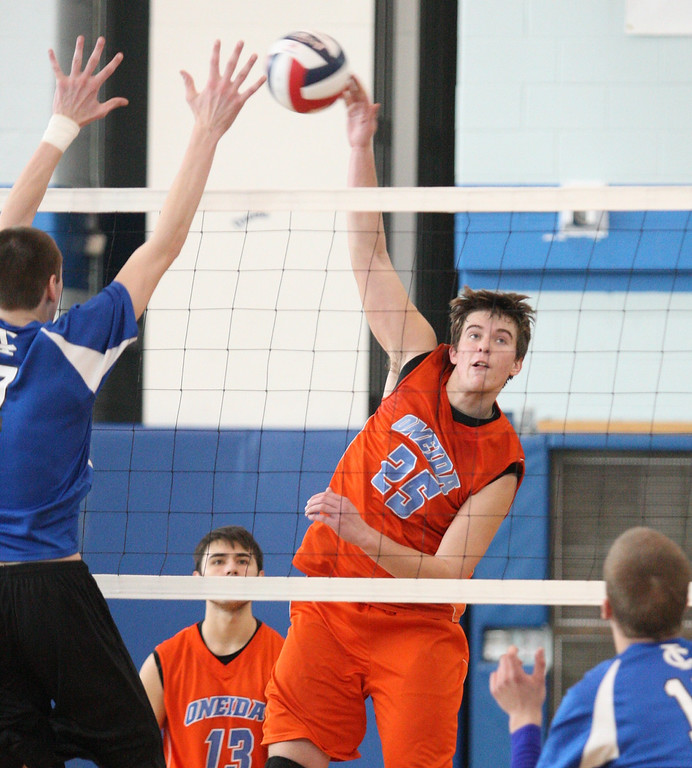 . Oneida\'s David Kann (25) puts the ball over the net as Ichabod Crane player defends in the NYSPHSAA Class B Regionals in Oneida on Saturday, March 8, 2014. JOHN HAEGER-ONEIDA DAILY DISPATCH @ONEIDAPHOTO ON TWITTER