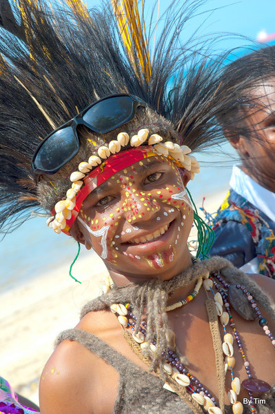 independence day celebrations. Young girl in the traditional head dress of the Port Morseby (Gulf of Papua) region with her obligatory fashion accessories; sunglasses.
