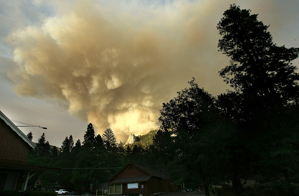 Description of . Smoke pours into the sky from the Mountain Fire near Idyllwild, Calif., Wednesday, July 17, 2013. Large parts of the Southern California communities of Idyllwild and Fern Valley were under evacuation orders with an estimated 300 to 400 homes affected, according to U.S. Forest Service spokeswoman Carol Jandrall. (AP Photo/Press Enterprise,Terry Pierson)